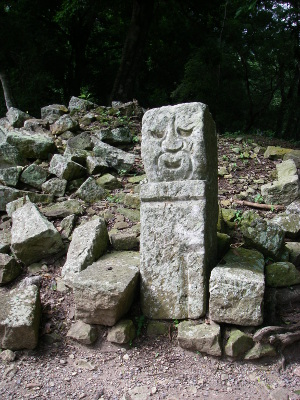 A stone face in the ruins at Copán.