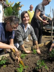 Patricia Echeverria tucks her plants in.