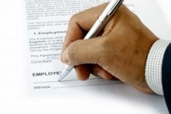 Employment Contact being signed by the employee