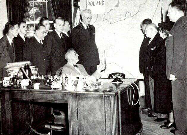 October 11, 1944: President Roosevelt greets Polish American Congress  delegation headed by Rozmarek (right) for Pulaski Day ceremonies while Polish uprising in Warsaw is being obliterated. The map on the wall shows Poland's pre-war boundaries even though FDR had already agreed to give eastern Poland to Stalin but kept this information secret from Polish American leaders.