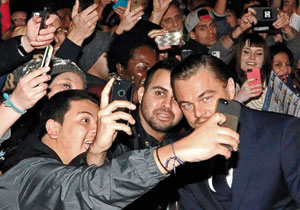 Leonardo DiCaprio meets fans on the red carpet before receiving the SBIFF award.