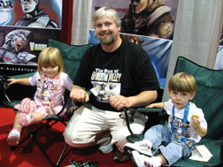 Andrew Clark, seen here at last year's Comic-con in San Diego with his children, returns to this year's Comic-con and is up for an Eisner Award, the comic world?s equivalent to an Oscar, for his 'The Guns of Shadow Valley,'seen below and at bottom. Courtesy photos