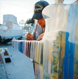 Local artist R. Nelson Parrish puts the finishing touches on his Sunset Strip-bound concept guitar. Parrish pulled 18-hour days to get it done. Instead of being in a gallery, the guitar will be out in the elements for a year, so one of Parrish's final coats was automobile clear-coat.