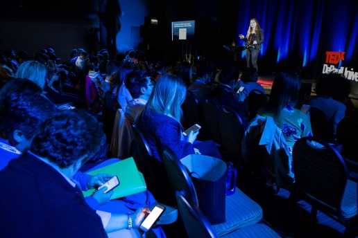 """Attendees check the amount of time they have spent using social media apps in their smartphones during Rachel Pride's talk """"Courage to Disconnect"""" at TEDxDePaulUniversity Tuesday, April 18, 2017, in the Lincoln Park Student Center. TEDxDePaulUniversity is an independently run, self-organized event. Through the theme """"Courage to Connect"""" 10 speakers from across the DePaul community challenged thoughts and inspired ideas through a series of engaging talks and presentations. (DePaul University/Jeff Carrion)"""