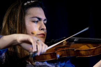 """Mariela Shaker plays her violin at the conclusion of her talk """"Healing Through Music: A Story of Hope from the Syrian Civil War"""" at TEDxDePaulUniversity Tuesday, April 18, 2017, in the Lincoln Park Student Center. TEDxDePaulUniversity is an independently run, self-organized event. Through the theme """"Courage to Connect"""" 10 speakers from across the DePaul community challenged thoughts and inspired ideas through a series of engaging talks and presentations. (DePaul University/Jeff Carrion)"""