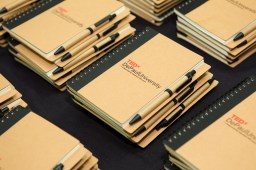 """Notebooks are among the gifts offered to attendees of TEDxDePaulUniversity Tuesday, April 18, 2017, in the Lincoln Park Student Center. TEDxDePaulUniversity is an independently run, self-organized event. Through the theme """"Courage to Connect"""" 10 speakers from across the DePaul community challenged thoughts and inspired ideas through a series of engaging talks and presentations. (DePaul University/Jeff Carrion)"""