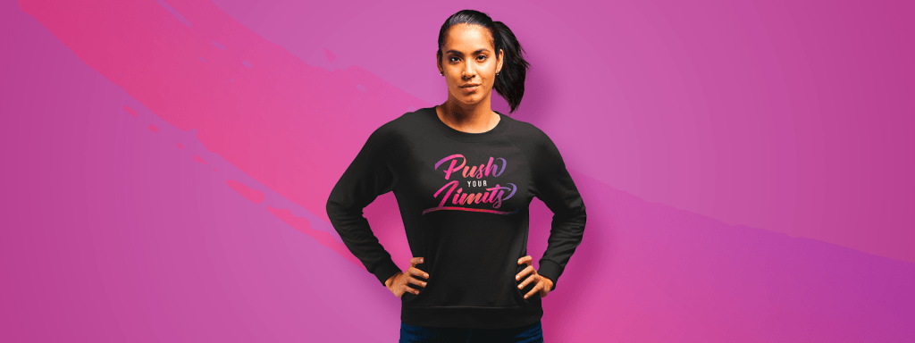 Young woman wearing long sleeve tee with inspirational quote