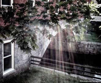 Sun's rays on little canal
