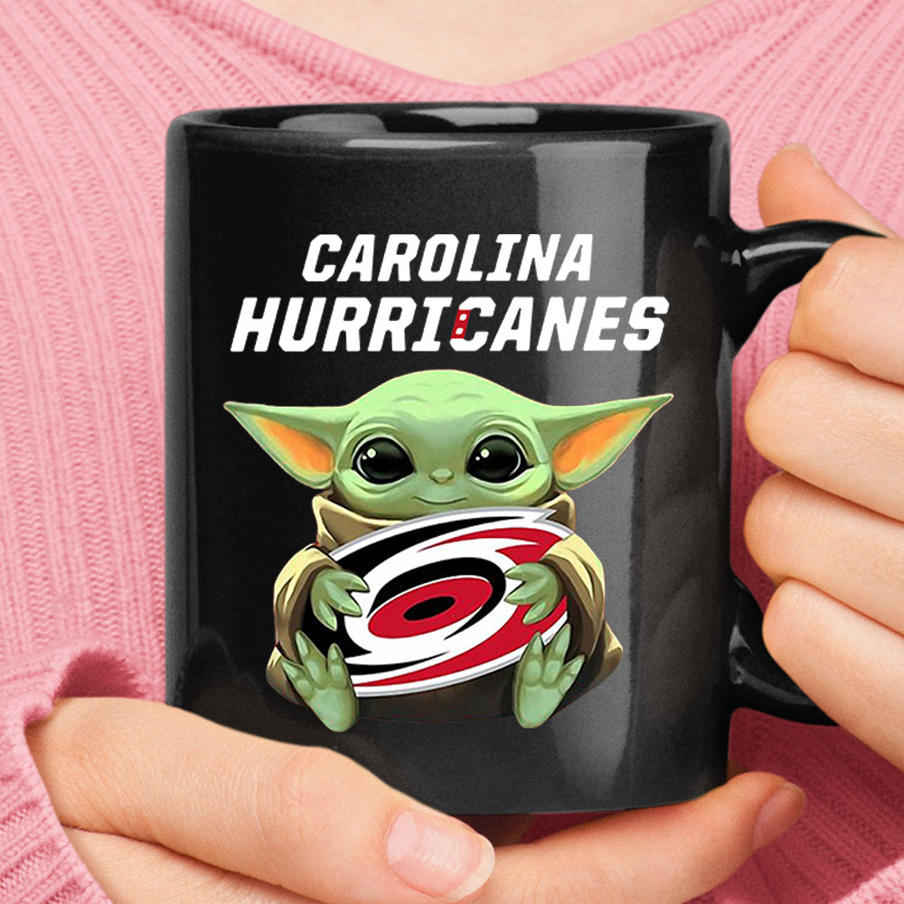 Baby Yoda Hugs The Carolina Hurricanes Ice Hockey Mug 1