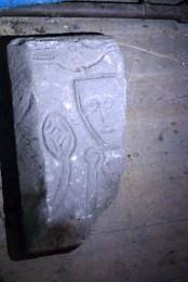 Stanwick Church woman wearing fillet & ? dolphin