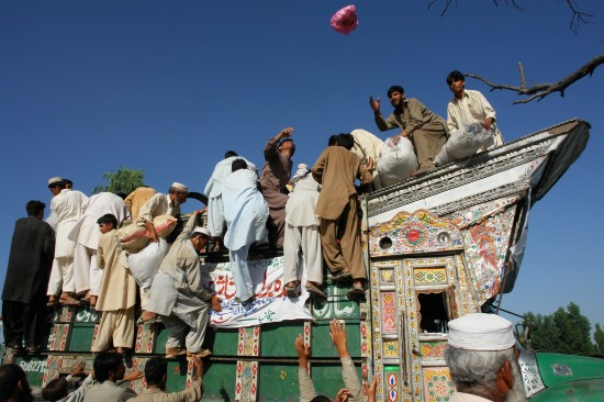 A truck laden with relief goods being ransacked
