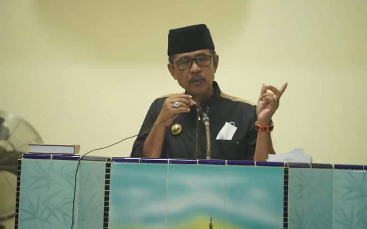 Bupati Kolut, Drs. H. Nur Rahman Umar. M. H saat memberi sambutan di depan masyarakat Desa Bangsala
