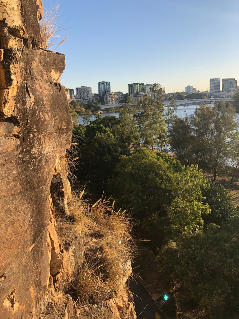 Mid-way point abseiling on cliff