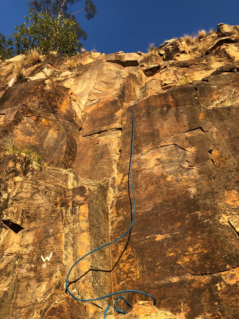 View from bottom of cliff with rope dangling