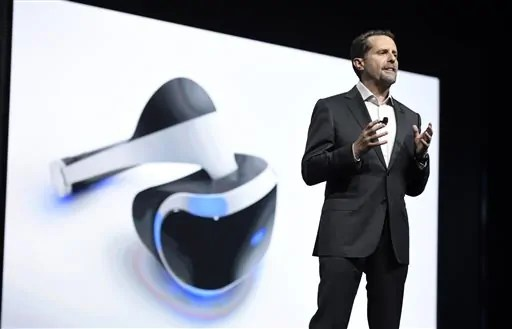 "FILE - In this June 15, 2015 file photo, Andrew House, president and global CEO of Sony Computer Entertainment Inc., talks about the Sony Morpheus virtual reality headset at the Sony Playstation at E3 2015 news conference in Los Angeles. From virtual reality to the latest installments of ""Gears of War"" and ""Battlefield,"" the newest hardware and software will be hyped by nearly 300 exhibitors at the Electronic Entertainment Expo, the gaming industry's annual trade show kicking off Sunday, June 12, 2016. (Photo by Chris Pizzello/Invision/AP, File)"