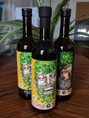 green tea in glass bottle