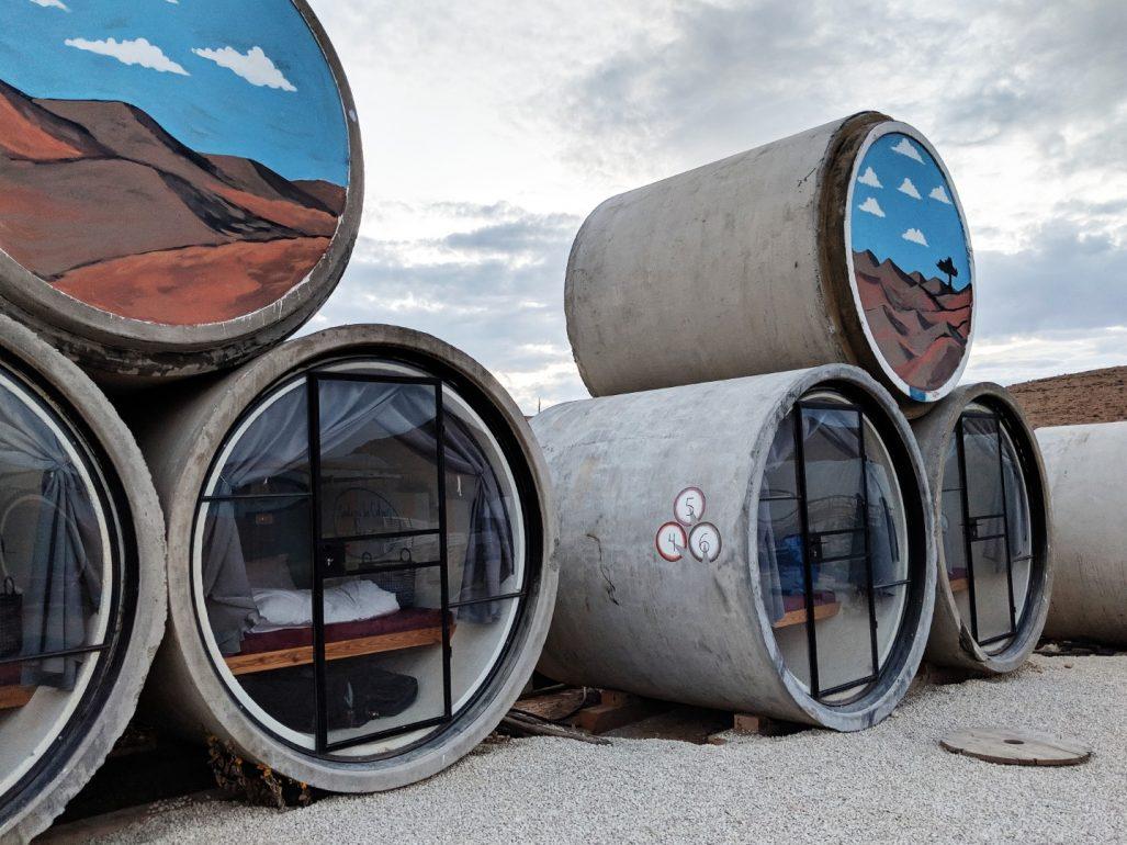 desert capsule hostel concrete tubes israel
