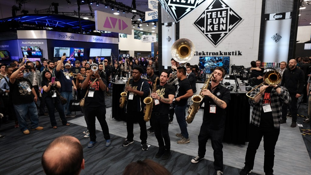Funky Dawgz Brass Band in front of the TELEFUNKEN Booth