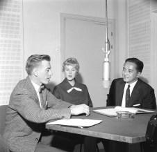 Reporter of the Finnish Broadcasting Corporation Esko Tommola interviews Armi Hilario (former Armi Kuusela) and her husband Gil Hilario in a radio studio.