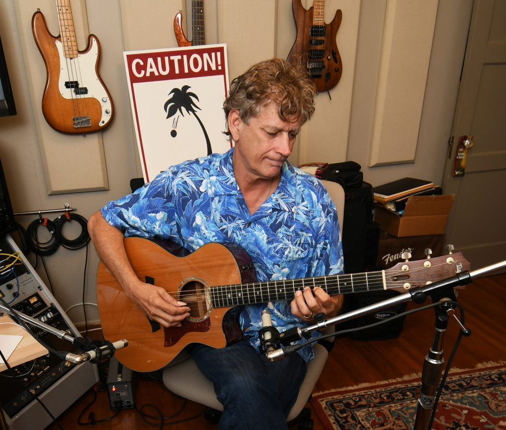 Jim West in his private studio with a matched pair of TELEFUNKEN ELA M 260s.  Photo by David Goggin.