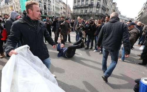 bruxelles l-hommage-aux-victimes-perturbe-par-des-hooligans-une-dizaine-d-interpellations-photos