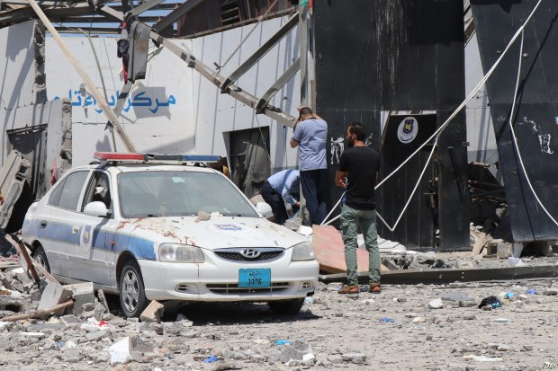3635: The morning after airstrikes hit a detention center holding migrants killed more than 50 people and injured at least 130, blood still stains the rubble as officials search for human remains, in Tripoli, Libya, July 3, 2019. (H. Murdock/VOA)