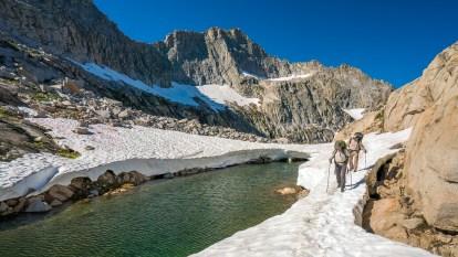 Crossing a Snow Bridge Above Precipice Lake