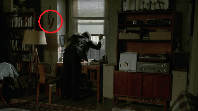 a screencap of ballet slippers in the mystery man's apartment