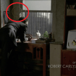 a screencap of a dreamcatcher hanging on the mystery man's wall