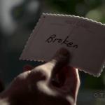 "a screencap of a postcard that reads ""broken"""