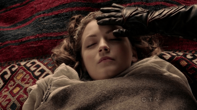 a screencap of mulan (played by jamie chung) stroking the head of aurora (played by sarah bolger)