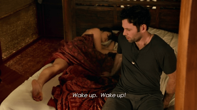 August Booth (played by eion bailey) on a bed beside isra (played by dianne doan)