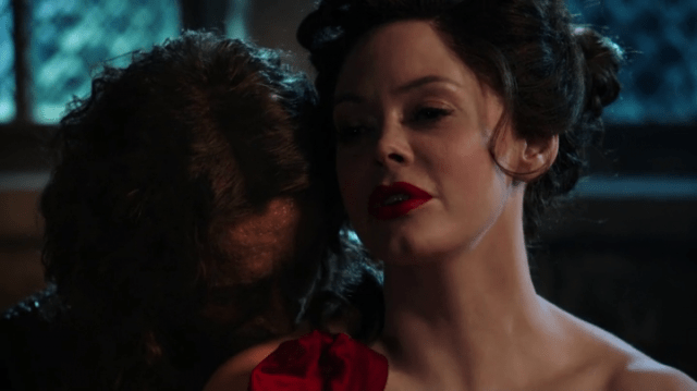 rumpelstiltskin (played by robert carlyle) kissing a young cora (played by rose mcgowan)