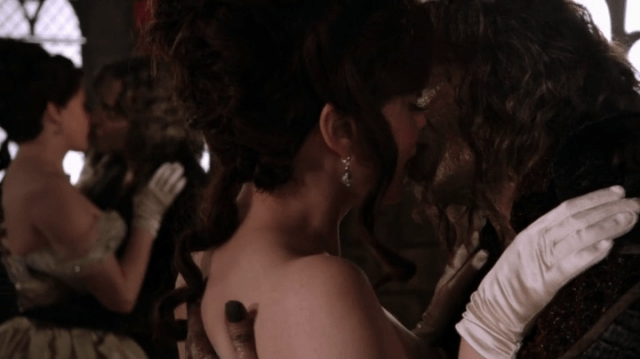 rumpelstiltskin (played by robert carlyle) kissing a young cora (played by rose mcgowan) yet again