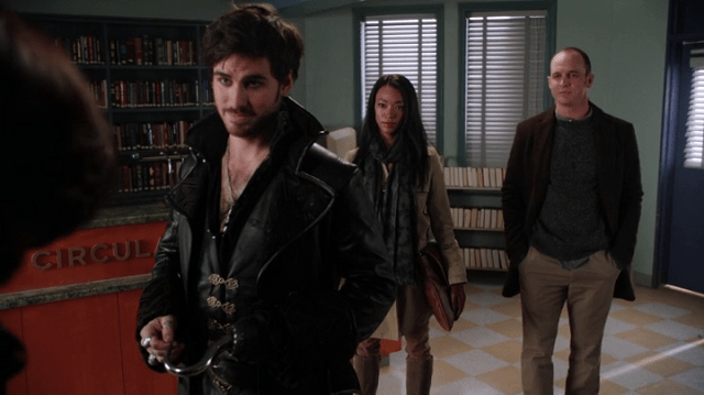 a screencap of captain hook (played by colin o'donaghue), tamara (played by sonequa martin-green) and greg mendell (played by ethan embry) gloating