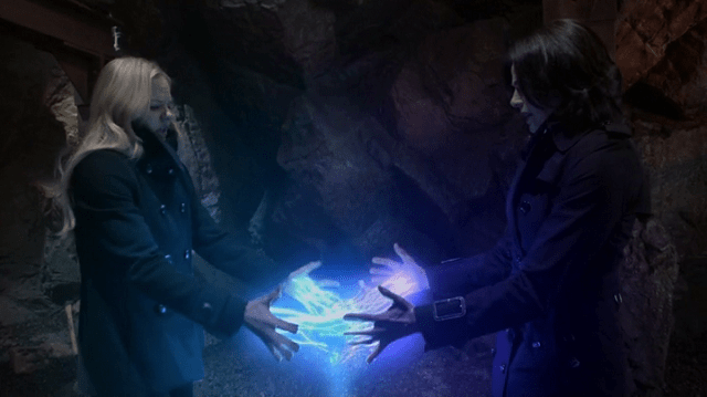 A SCREENCAP OF EMMA SWAN (PLAYED BY JENNIFER MORRISON) AND REGINA MILLS (PLAYED BY LANA PARRILLA) COMBING THEIR MAGIC TO STOP THE DOOMSDAY DEVICE