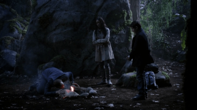 a screencap of greg mendell (played by ethan embry) starting a fire while tamara (played by sonequa martin-green) and henry (played by jared s. gilmore) look on