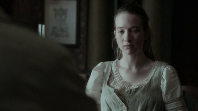 a screencap of alice (played by sophie lowe)