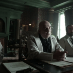 a screencap of dr. lyndgate (played by jonny coyne) and his two colleagues (played by ryan elm and michael q. adams)