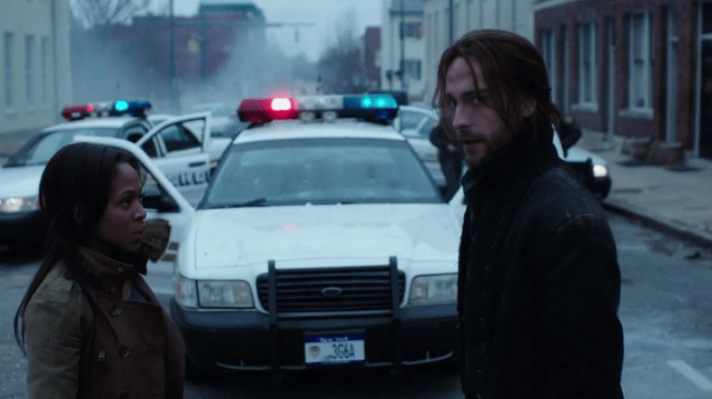 a screencap of Lt. Abbie Mills (played by nicole beharie) and ichabod crane (played by tom mison)