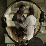 a screencap of a younger grendel (played by steve bacic) and his wife (played by catherine michaud)