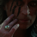 a screencap of rumpelstiltskin (played by robert carlyle) applying warpaint