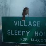 a screencap of the sleepy hollow village sign