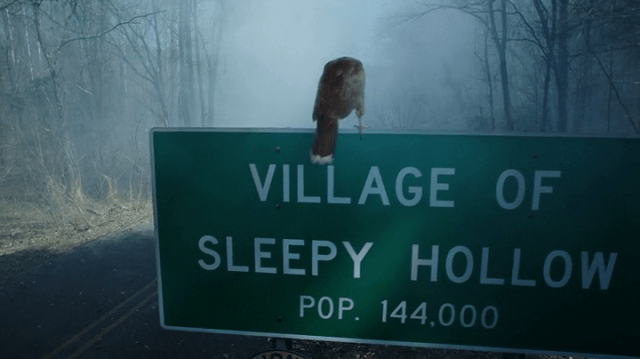 a screencap of the sleepy hollow village sign
