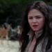 a screencap of Snow White (played by Ginnifer Goodwin) with a deer behind her in the background