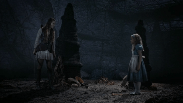 a screencap of alice (played by sophie lowe) meeting her younger self doppelganger (played by millie brown)
