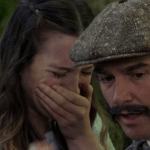 a screencap of alice (played by sophie lowe) reunited with her father, edwin (played by shaun smyth)