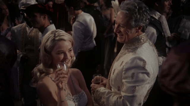 a screencap of anastasia (played by emma rigby) flirting with the king (played by garwin sanford)