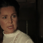 a screencap of anastasia's mother (played by sarah-jane redmond) being angry