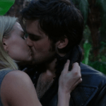 a screencap of emma (played by jennifer morrison) kissing captain hook (played by colin o'donoghue)